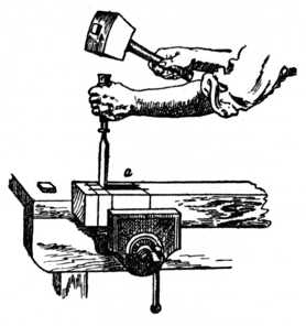 Fig. 183.—Using the Chisel and Mallet for Mortising.