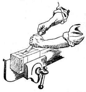 Fig. 184.—Removing Waste of Mortise with Chisel.